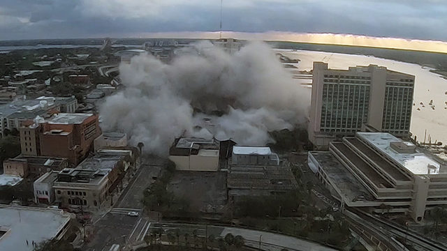 Timelapse from above: Cloud of dust rises after implosion