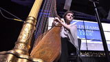 Harpist surprised with new instrument after leukemia treatment