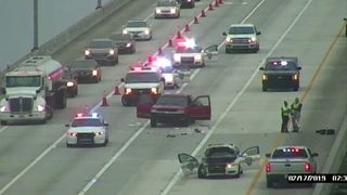 Officer hits stalled truck on Buckman Bridge, JSO says