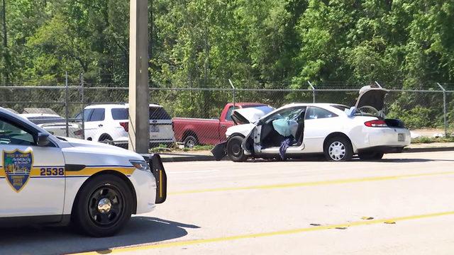 Woman dies after car strikes pole in Mandarin
