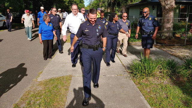 Walk aims to improve communication between Grand Park residents, police