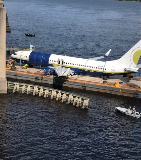 FHP pix of plane on barge passing under Buckman Bridge