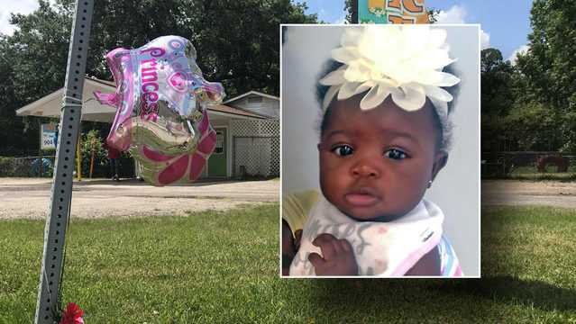 Baby who died in day care van honored at vigil