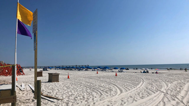 Packed beaches have lifeguards busy making rescues