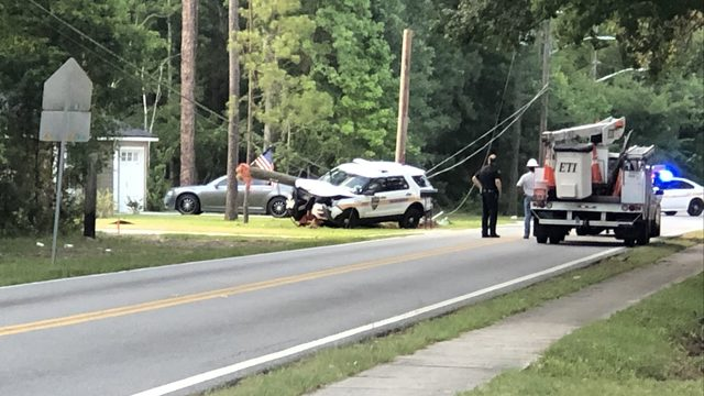 Jacksonville Sheriff's Office cruiser hits light pole on Westside