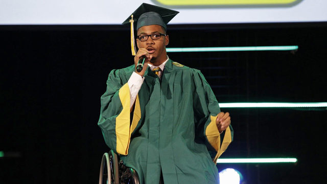 Wheelchair-bound graduate calls walk to get diploma 'liberating'