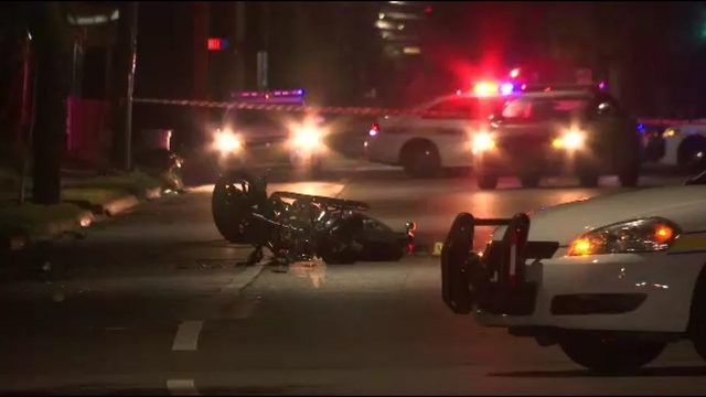 Motorcyclist dies after crashing into pole