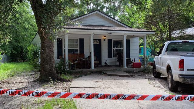 Gunshots fired into home kill woman as children slept