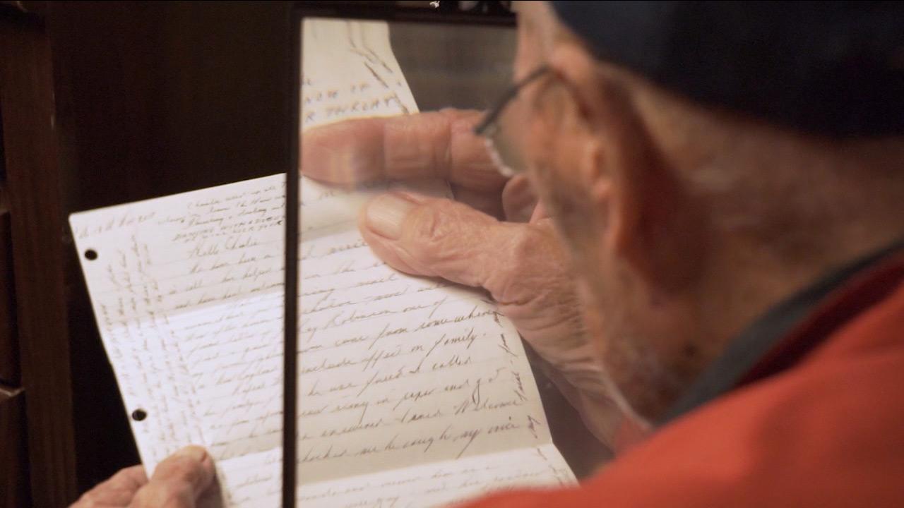 Charles Hopkins reads letter