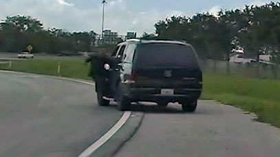 Dashcam image of deputy dragged