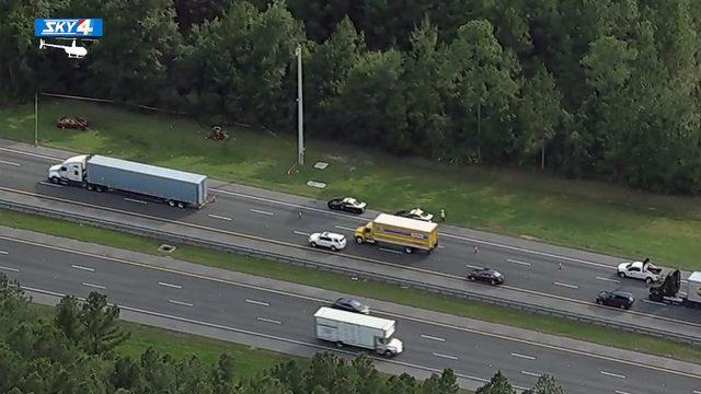 Crash involving man on riding mower blocks lanes of I-95