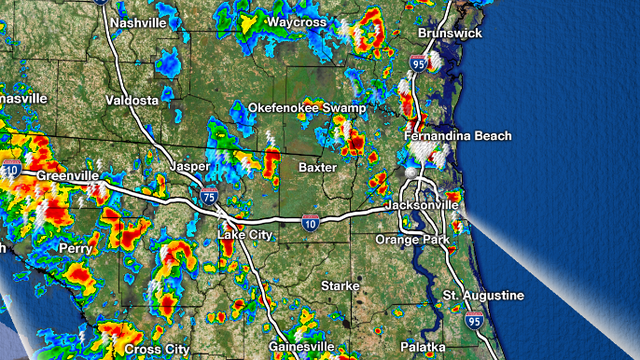 Slow moving downpours move through, fade this evening