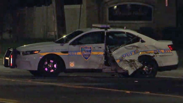Officer not hurt, woman taken to hospital after Westside crash