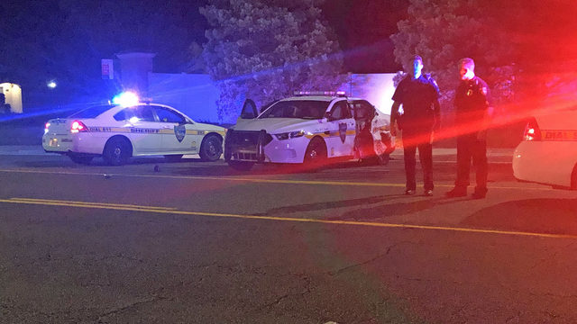 Officer unhurt, woman taken to hospital after Westside crash