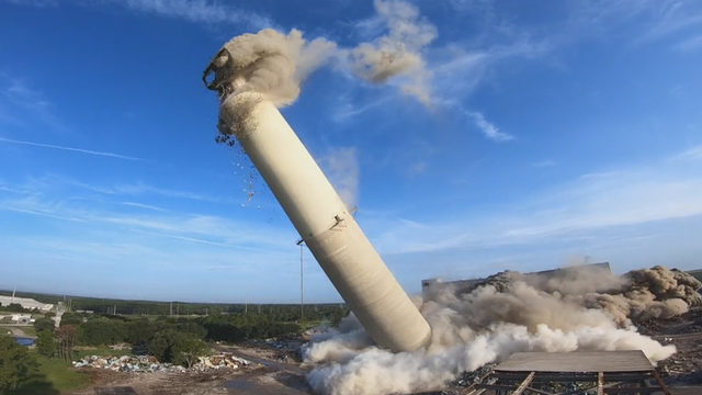 Power plant's smokestack, boilers come down with a bang
