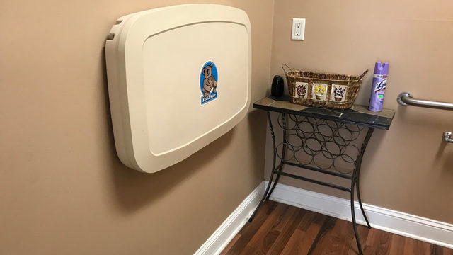 Pampers installs changing table at barbershop thanks to Jacksonville dad