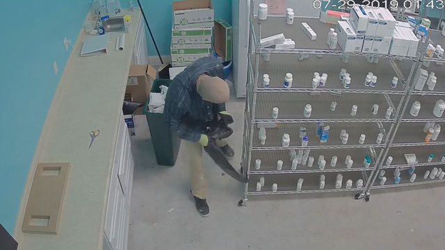 Police: Masked man breaks into pharmacy with ax, steals drugs