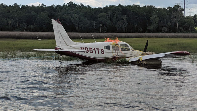Small plane that went down in river towed to dry land Sunday