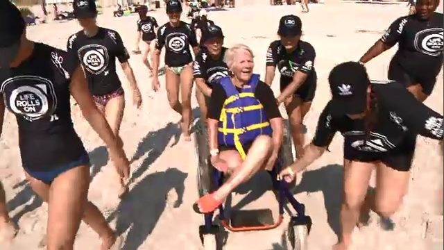 Group of disabled surfers defy odds in adaptive surfer event