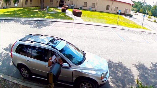 Camera captures envelopes being removed from church's mailbox