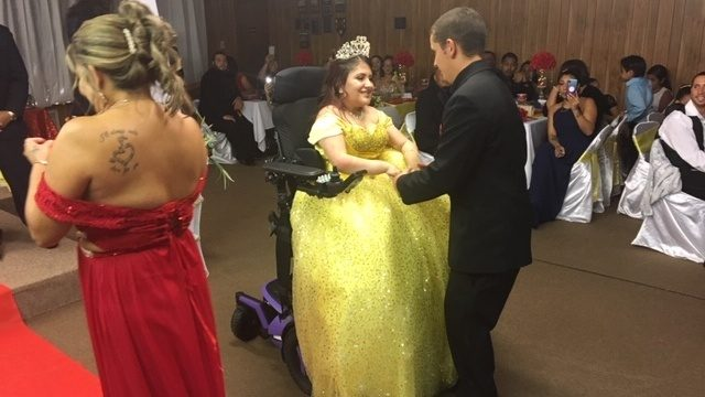 Teen born with spina bifida stands, dances during birthday celebration