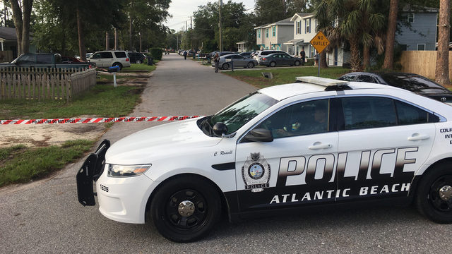 Police: Man hurt when shots fired into home with kids inside