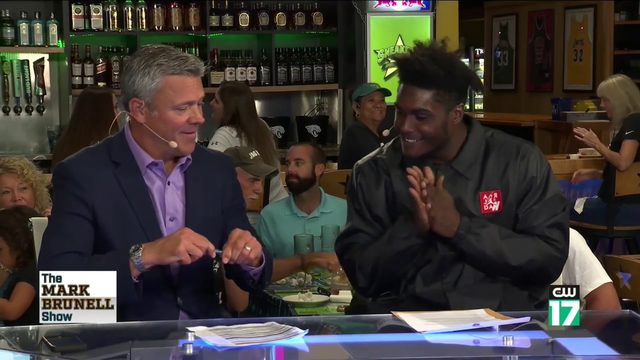 Myles Jack signs 'Mark Brunell Show' contract on air