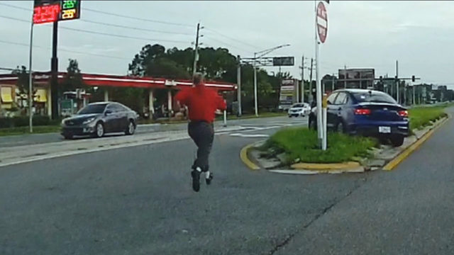 Dashcam captures good Samaritan stopping runaway car after crash