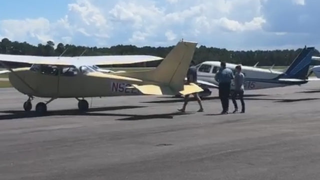 Missing boater's wife clutches Bible as she boards plane to continue search