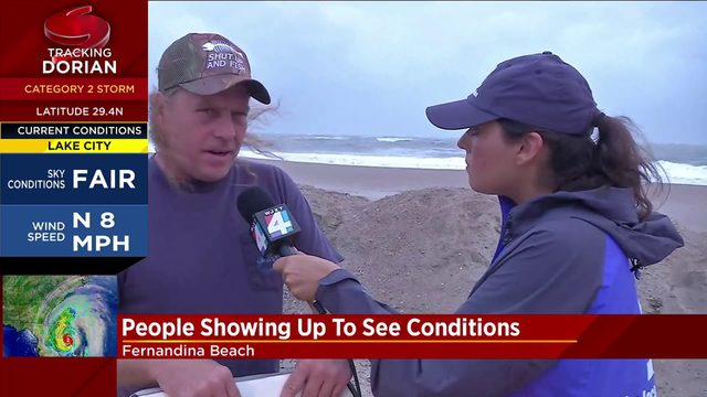 Unfazed by Hurricane Dorian, people flock to Florida's beaches