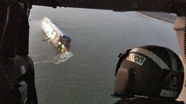 Coast Guard searching for 4 aboard flipped cargo ship near Brunswick
