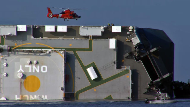 Noises heard as Coast Guard searches for 4 in capsized cargo ship