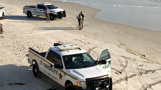 Deputies: Body found on beach could be missing swimmer