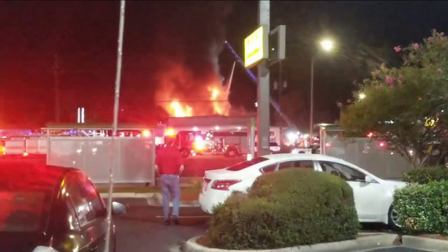 Firefighters battle flames at furniture store on Beach Boulevard