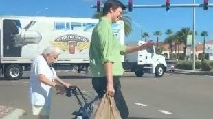 Publix employee helps elderly woman cross busy Jacksonville Beach street