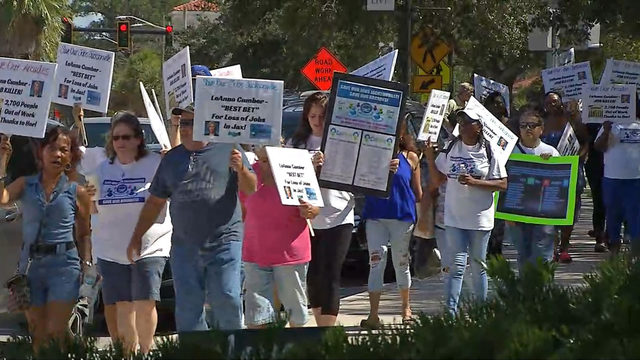 Adult arcade employees march to protest impending closures