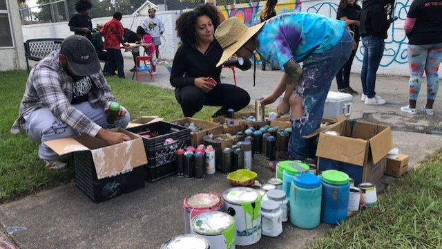 Jacksonville artists paint murals with teens in Grand Park