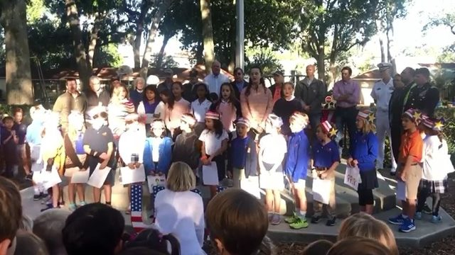 Local students read poem, sing for veterans at flag ceremony